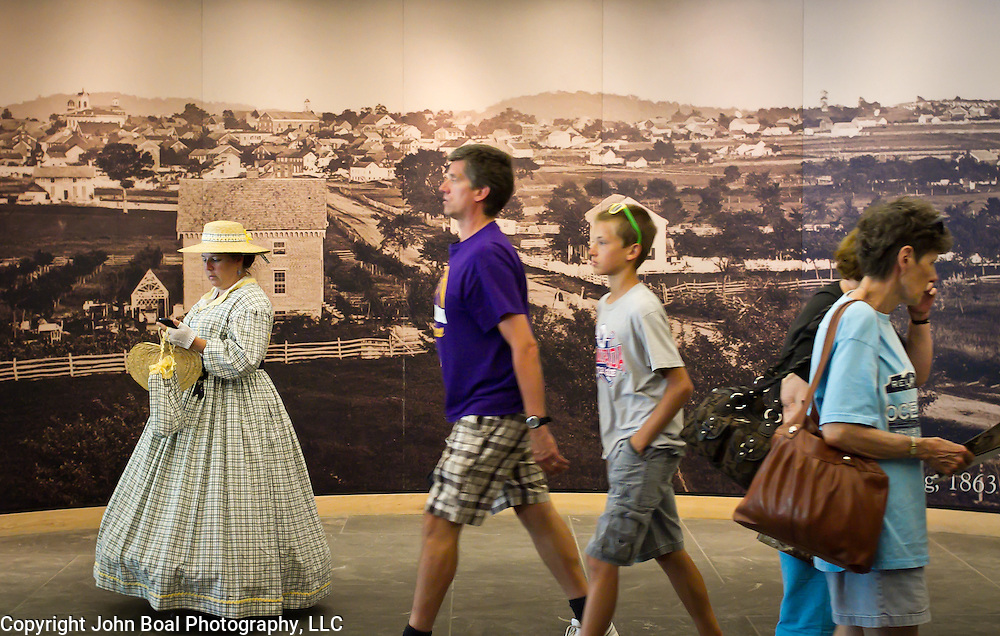 Visitors make their way past murals and civilian reenactors inside the Gettysburg National Military Park Visitors Center, during the Sesquicentennial Anniversary of the Battle of Gettysburg, Pennsylvania on Sunday, June 30, 2013.  A pivotal moment in the Civil War, over 50,000 soldiers were killed, wounded or missing after 3 days of battle from July 1-3, 1863.  Later that year, President Abraham Lincoln returned to Gettysburg to deliver his now famous Gettysburg Address to dedicate the cemetery there for the Union soldiers who died in battle.  John Boal photography