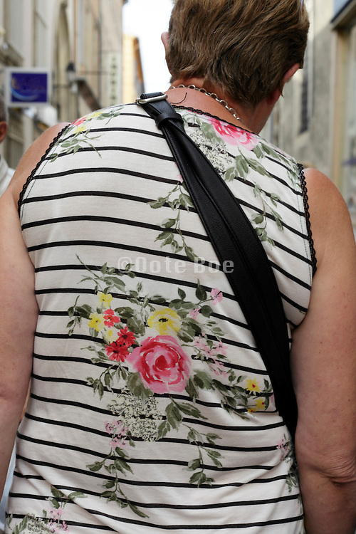 adult woman wearing a t-shirt with a flower design