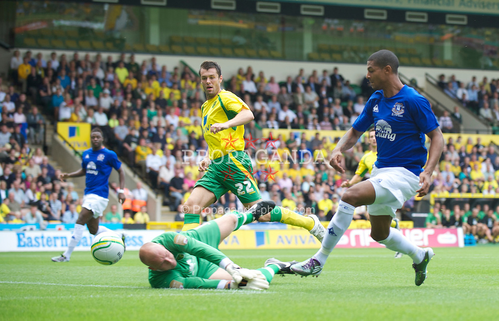 NORWICH, ENGLAND - Saturday, July 31, 2010: Everton's Jermaine Beckford is denied by Norwich City's goalkeeper John Ruddy during a preseason friendly match at Carrow Road. (Pic by David Rawcliffe/Propaganda)