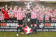Kyle Storer and Aaron Downes and the Cheltenham team celebrate the championship after the Vanarama National League match between Cheltenham Town and Lincoln City at Whaddon Road, Cheltenham, England on 30 April 2016. Photo by Antony Thompson.