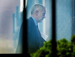 © Licensed to London News Pictures. 24/06/2016. London, UK. Labour Party Leader Jeremy Corbyn walks back to his office after attending a shadow cabinet meeteing. Two Labour MPs have submitted a motion of no confidence in Mr Corbyn. Prime Minister David Cameron has resigned after the UK EU referendum result was announced with a victory for the leave campaign. Photo credit: Peter Macdiarmid/LNP