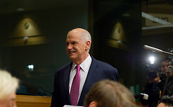 George Papandreou, Greece's prime minister, arrives for a news conference following the European Summit, in Brussels, on Friday, March 26, 2010. (Photo © Jock Fistick)