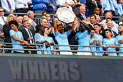 Riyad Mahrez of Manchester City lifts the Community Shield as Manchester City celebrate winning 2-0 - Rogan/JMP - 05/08/2018 - FOOTBALL - Wembley Stadium - London, England - Chelsea v Manchester City - The FA Community Shield.