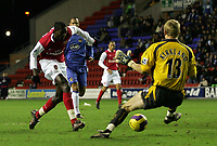 Photo: Paul Thomas.<br /> Wigan Athletic v Arsenal. The Barclays Premiership. 13/12/2006.<br /> <br /> Emmanuel Adebayor scores for Arsenal.