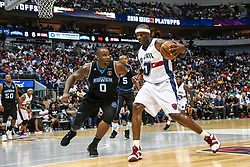 August 17, 2018 - Dallas, TX, U.S. - DALLAS, TX - AUGUST 17: Tri-State Jermaine O'Neal #7 tries to dribble around Power Glen Davis #0 during the Big 3 Basketball playoff game between the Power and the Tri-State on August 17, 2018 at the American Airlines Center in Dallas, Texas. Power defeats Tri-State 51-49. (Photo by Matthew Pearce/Icon Sportswire) (Credit Image: © Matthew Pearce/Icon SMI via ZUMA Press)