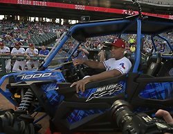 September 8, 2017 - Arlington, TX, USA - Texas Rangers third baseman Adrian Beltre checks out his new ATV, given to him as part of the celebration of his reaching the 3,000-hit plateau earlier this season, before a game against the New York Yankees at Globe Life Park in Arlington, Texas, on Friday, Sept. 8, 2017. (Credit Image: © Max Faulkner/TNS via ZUMA Wire)
