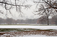 Snow drifts and a hazy skyline at the Great Lawn in Central Park