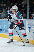 KELOWNA, CANADA -FEBRUARY 5: Carter Rigby #11 of the Kelowna Rockets handles the puck behind the net against the Red Deer Rebels on February 5, 2014 at Prospera Place in Kelowna, British Columbia, Canada.   (Photo by Marissa Baecker/Getty Images)  *** Local Caption *** Carter Rigby;