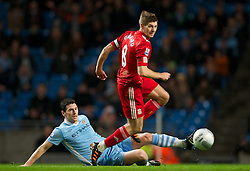 11.01.2012, Etihad Stadion, Manchester, ENG, Carling Cup, Manchester City vs FC Liverpool, Halbfinale, im Bild Liverpool's captain Steven Gerrard in action against Manchester City's Gareth Barry during the football match of English Carling Cup, Halffinal, between Manchester City and FC Liverpool at Etihad Stadium, Manchester, United Kingdom on 2012/01/11. EXPA Pictures © 2012, PhotoCredit: EXPA/ Propagandaphoto/ David Rawcliff..***** ATTENTION - OUT OF ENG, GBR, UK *****