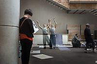 Dancer limbers up at National Museum of Scotland, in Edinburgh, Scotland. Copyright 2019 Reid McNally.
