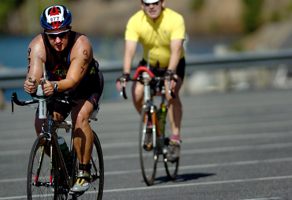 JEROME A. POLLOS/Press..John Theriot, of Alexandria, La., pedals through the turnaround at Higgens Point during the 112-mile bike course.