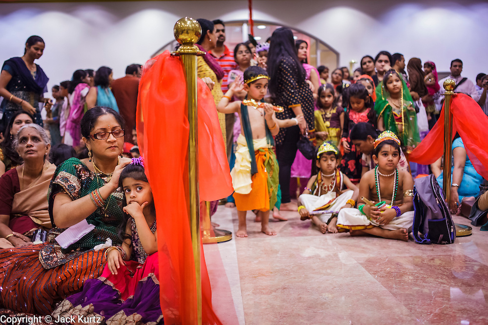 10 AUGUST 2012 - PHOENIX, AZ:    People watch a children's pageant of Krishna and Rhada during the celebration of Janmashtami at Ekta Mandir, a Hindu temple in central Phoenix. Janmashtami is the Hindu holy day that celebrates the birth of Lord Krishna. Hindu communities around the world celebrate the holy day. In Arizona, most of the Hindu temples in the Phoenix area have special celebrations of the day.  PHOTO BY JACK KURTZ
