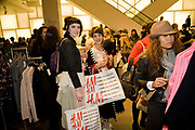 ALICE CARVILL-WHITE; CLAIRE BURROW; , H & M preview of Come Des Garcons for H & M. H & M Regent St. London W1. 12 November 2008.  *** Local Caption *** -DO NOT ARCHIVE-© Copyright Photograph by Dafydd Jones. 248 Clapham Rd. London SW9 0PZ. Tel 0207 820 0771. www.dafjones.com.