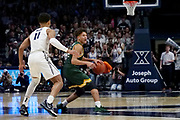 Jordan King (14) of Siena looks for an open player as he's guarded by Bryce Moore (11) of Xavier during an NCAA college basketball game, Friday, Nov. 8, 2019, at the Cintas Center in Cincinnati, OH. Xavier defeated Siena 81-63. (Jason Whitman/Image of Sport)