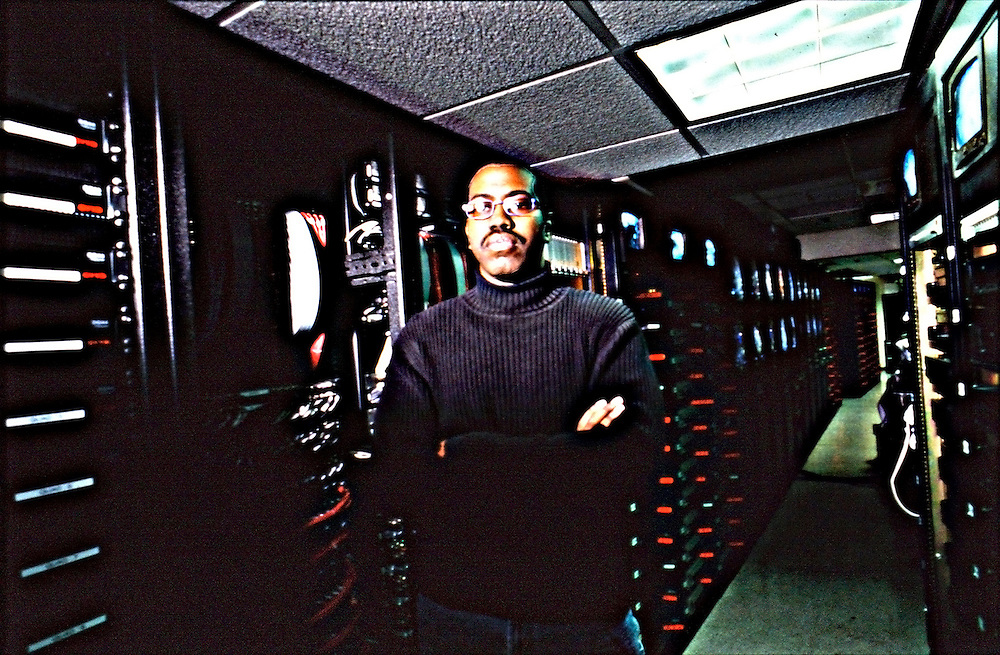 Electronic security officer stands in front of a bank of servers .