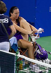 Jelena Jankovic of Serbia was assisted after injury of her left ankle during play against Anastasiya Yakimova of Belarus  at 2nd Round of Singles at Banka Koper Slovenia Open WTA Tour tennis tournament, on July 22, 2010 in Portoroz / Portorose, Slovenia. (Photo by Vid Ponikvar / Sportida)