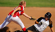 9 OCT. 2010 -- ARNOLD, Mo. -- Cor Jesu Academy infielder Lauren Venhaus (17) fails to apply a tag to Oakville High School's Julie Kernen (19) at second base during Chargers' game against Oakville High School at the MSHSAA Class 4 Distirct 2 softball championships at Fox High School in Arnold, Mo. Saturday, Oct. 9, 2010. The Tigers won the game, 3-0, the advance in the playoffs. Image © copyright 2010 Sid Hastings.
