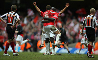 Photo: Rich Eaton.<br /> <br /> Grimsby Town v Cheltenham Town. Coca Cola League 2. Play off Final. 28/05/2006. Shane Duff and Damien Spencer celebrate promotion to league 1 as dejected Grimsby players walk off the pitch