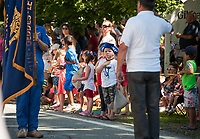 Carson stands with his hand over his heart as the Color Guard marches by during the Gilmanton 4th of July parade on Wednesday morning.  (Karen Bobotas/for the Laconia Daily Sun)