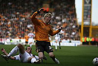 Photo: Rich Eaton.<br /> <br /> Wolverhampton Wanderers v West Bromwich Albion. Coca Cola Championship. 11/03/2007. Andy Keogh of Wolves #39 is tackled by Paul Robinson of West Brom