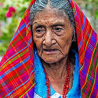 PANCHIMALCO , EL SALVADOR - MAY 08 : Portrait of an old Salvadoran woman during the Flower & Palm Festival in Panchimalco, El Salvador on May 08 2016