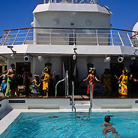 Oceania, South Pacific, French Polynesia, Tahiti. Tahitian dancers on the Paul Gaughin.
