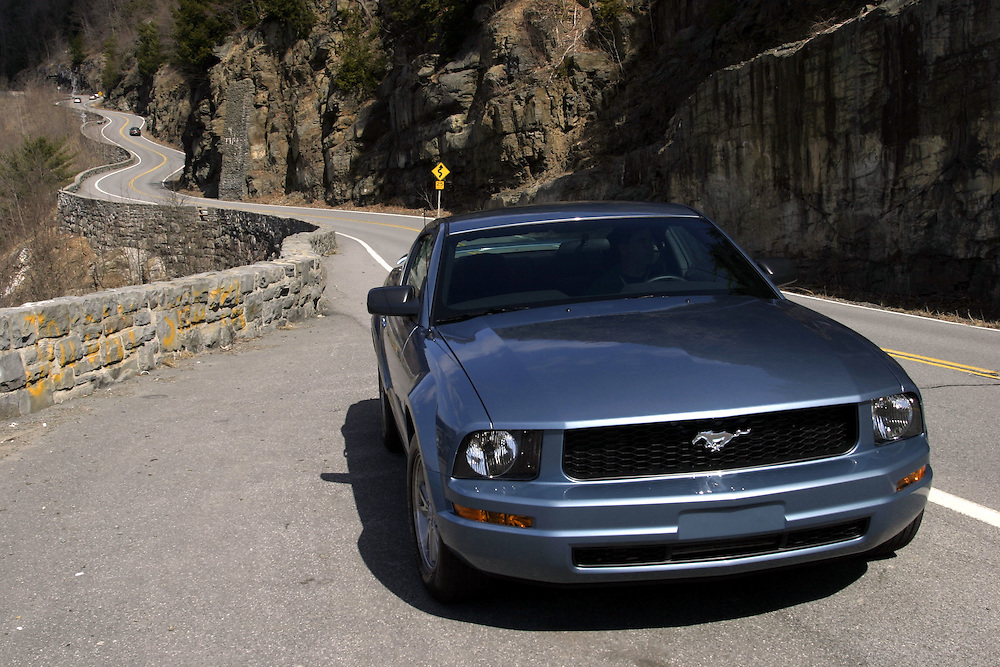 New York..Saturday, March 18, 2006....Pete Hahkins, of Narrowsburg, drives his Mustang along the winding road of State Route 97 between Narrowsburg and Port Jervis in upstate New York, on Saturday, March 18, 2006. The road is considered among the best driving roads in America according to a poll of the top 25 Porsche reviewers...