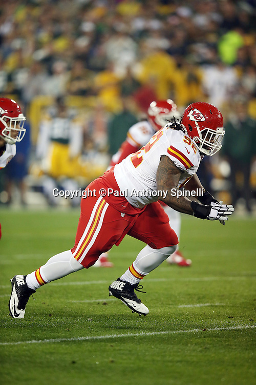 Kansas City Chiefs nose tackle Dontari Poe (92) rushes the quarterback during the 2015 NFL week 3 regular season football game against the Green Bay Packers on Monday, Sept. 28, 2015 in Green Bay, Wis. The Packers won the game 38-28. (©Paul Anthony Spinelli)