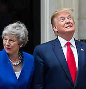 Donald Trump, US President and First Lady Melania Trump arrive in Downing Street as part of their State visit. Theresa May, Prime Minister and Mr May greet them on the doorstep of No.10 Downing Street, London, Great Britain <br /> 4th June 2019 <br /> L to R: <br /> Theresa May <br /> Donald Trump<br /> <br /> <br /> <br /> Photograph by Elliott Franks
