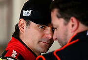 Feb 20, 2013; Daytona Beach, FL, USA; NASCAR Sprint Cup Series driver Jeff Gordon (24) talks with Tony Stewart (14) during practice for the Daytona 500 at Daytona International Speedway. Mandatory Credit: Douglas Jones-DDJ Sports Imaging