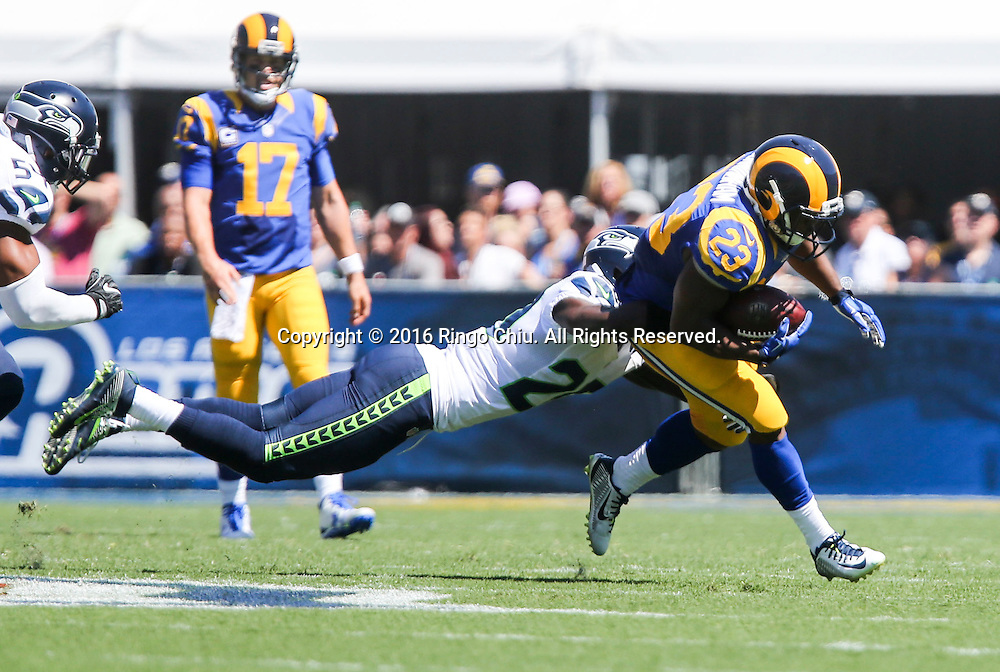 Los Angeles Rams running back Benny Cunningham (23) is defended by Seattle Seahawks cornerback Jeremy Lane (20) during a NFL football game, Sunday, Sept. 18, 2016, in Los Angeles. The Rams won 9-3. (Photo by Ringo Chiu/PHOTOFORMULA.com)<br /> <br /> Usage Notes: This content is intended for editorial use only. For other uses, additional clearances may be required.