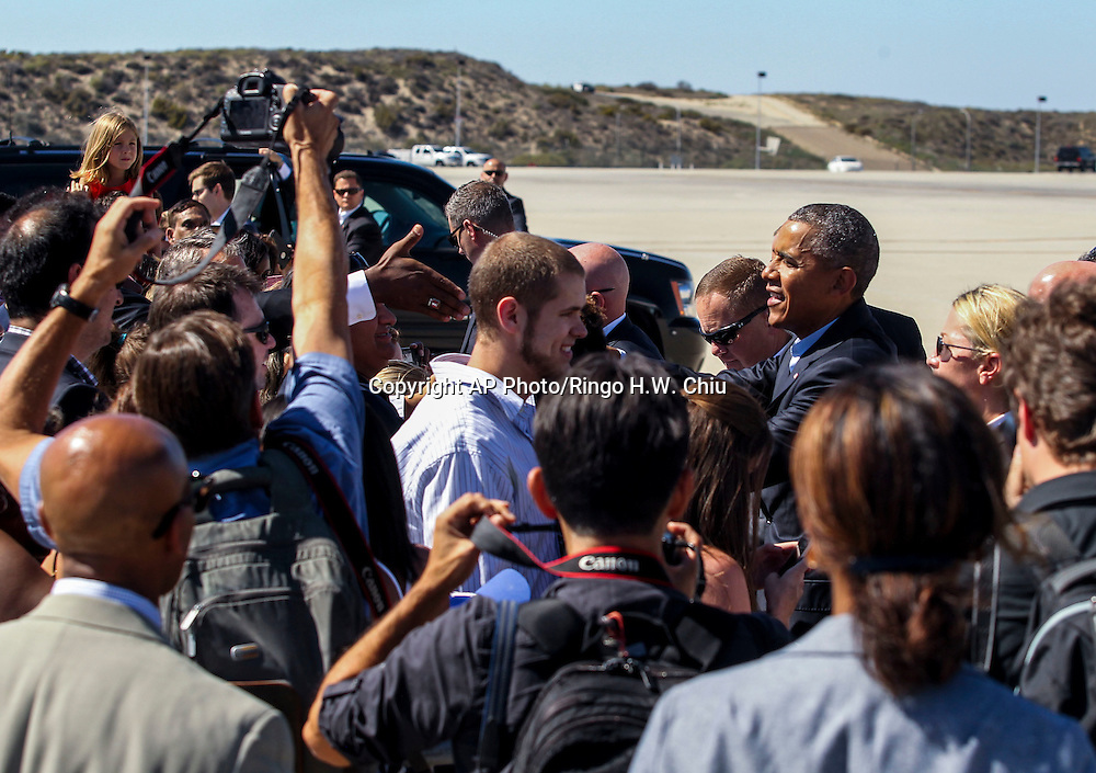 President Barack Obama greets people as he arrives on Air Force One at Los Angeles International Airport in Los Angeles  Sunday, Oct. 10, 2015.  (AP Photo/Ringo H.W. Chiu)