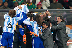 Coach Diego Maradona and his players celebrate during the 2010 FIFA World Cup South Africa Round of Sixteen match between Argentina and Mexico at Soccer City Stadium on June 27, 2010 in Johannesburg, South Africa. Argentina defeated Mexico 3-1 and qualified for quarterfinals. (Photo by Vid Ponikvar / Sportida)