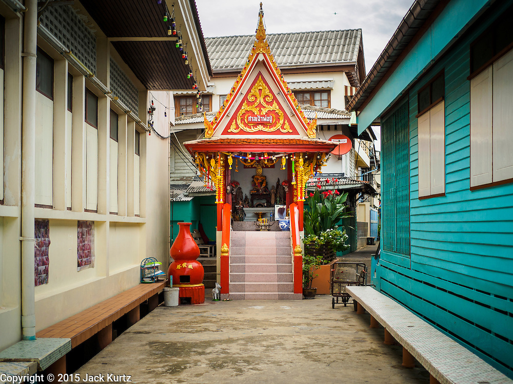 20 JULY 2015 - NONTHABURI, NONTHABURI, THAILAND:  A Buddhist shrine in a riverfront community in Nonthaburi, a suburb of Bangkok. This area is supposed to be redeveloped and the people who live here may be evicted to make way for the redevelopment. The Chao Phraya promenade is development project of parks, walkways and recreational areas on the Chao Phraya River between Pin Klao and Phra Nang Klao Bridges. The 14 kilometer long promenade will cost approximately 14 billion Baht (407 million US Dollars). The project involves the forced eviction of more than 200 communities of people who live along the river, a dozen riverfront  temples, several schools, and privately-owned piers on both sides of the Chao Phraya River. Construction is scheduled on the project is scheduled to start in early 2016. There has been very little public input on the planned redevelopment.          PHOTO BY JACK KURTZ