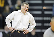 December 8, 2011: Iowa Hawkeyes head coach Tom Brands yells instructions to Josh Dziewa in the 149 pound bout of the NCAA wrestling dual between the Northern Iowa Panthers and the Iowa Hawkeyes at Carver-Hawkeye Arena in Iowa CIty, Iowa on Thursday, December 8, 2011. Dziewa defeated Welter 14-6 and Iowa defeated Northern Iowa 38-4.
