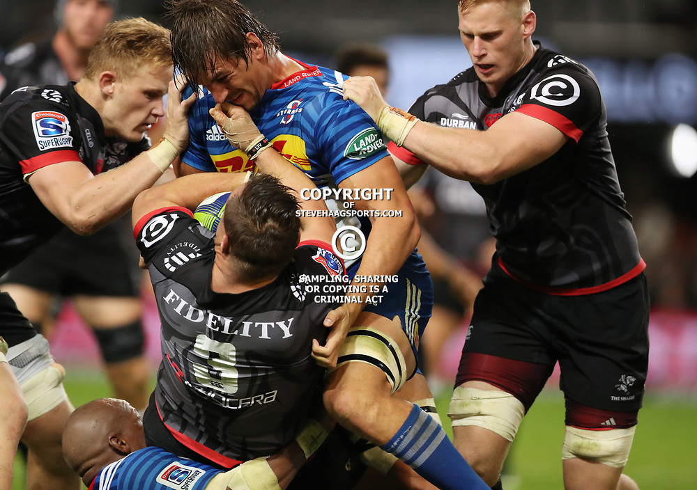 DURBAN, SOUTH AFRICA - MAY 27: Eben Etzebeth (vice-captain) of the DHL Stormers tackling Coenie Oosthuizen of the Cell C Sharks during the Super Rugby match between Cell C Sharks and DHL Stormers at Growthpoint Kings Park on May 27, 2017 in Durban, South Africa. (Photo by Steve Haag/Gallo Images)