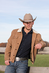 Good looking All American cowboy on a ranch
