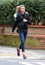 Model Abbey Clancy narrowly escapes her car from being towed in London, UK. 07/03/2014<br />BYLINE MUST READ : JAMESY/GOTCHA IMAGES<br /><br />Copyright by © Gotcha Images Ltd. All rights reserved.<br />Usage of this image is conditional upon the acceptance <br />of Gotcha Images Ltd, terms and conditions available at<br />www.gotchaimages.com