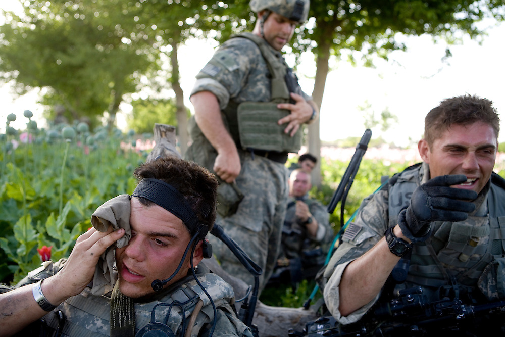 After a day of walking, searching, and fighting Taliban forces in very hot and humid conditions, Sargeants Jeremy Johnson, left, and Ryan Doolittle, right,   take a break near Sangin, Helmand province, Afghanistan on Wednesday, April 11. 2007.