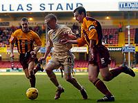 Photo: Jed Wee.<br />Bradford City v Bristol City. Coca Cola League 1. 18/02/2006.<br />Bristol's Dave Cotterill (C) tries to get past Bradford's David Wetherall.