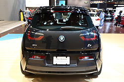 "12 February 2015: 2015 BMW i3: A must-see vehicle in the BMW exhibit during the 2015 Chicago Auto Show is the all-new  BMW i3 electric car, constructed in a revolutionary way from next-generation materials.  The i3 went on sale in the US market in the second quarter of 2014 as a 2015 model. This is BMW's first truly purpose-built electric car, and first vehicle to utilizing the new""i sub-brand.  For 2015, the BMW i3 comes in three different worlds: Mega, Giga and Tera, all featuring LifeDrive architecture concept comprised of two modules; the Life Module, and the Drive Module. Think of the Life Module as the passenger cabin, or greenhouse. It is the first-ever mass produced Carbon Fiber Reinforced Plastic (CFRP) passenger cell in the automotive business. The Drive Module, which is constructed out of 100% aluminum, consists of the 22-kWh, 450 lb. lithium-ion battery, electric drive train, MacPherson strut and five-link rear suspension system and structural and crash components. The result is an electric car that weighs about 2,700 lbs (preliminary US figures). With the battery mounted in the rear, close to the drive wheels, the i3 gives impressive performance characteristics while also providing better traction.  Assisting the eDrive rear-wheel drive powertrain, are unique 19-inch tires that have low rolling resistance, and frame the light-alloy wheels. Offering a small turning circle of 32.3 feet, – a major benefit to driving in the city – the i3 still has a perfect 50-50 weight distribution.<br /> <br /> First staged in 1901, the Chicago Auto Show is the largest auto show in North America and has been held more times than any other auto exposition on the continent. The 2015 show marks the 107th edition of the Chicago Auto Show. It has been  presented by the Chicago Automobile Trade Association (CATA) since 1935.  It is held at McCormick Place, Chicago Illinois"