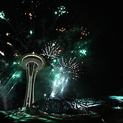 The 9th Annual Indulgence 2011 at the EMP: Seattle's Largest New Year's Eve Bash.   Fireworks at the Space Needle above Indulgence 2011 venue, EMP/SFM.