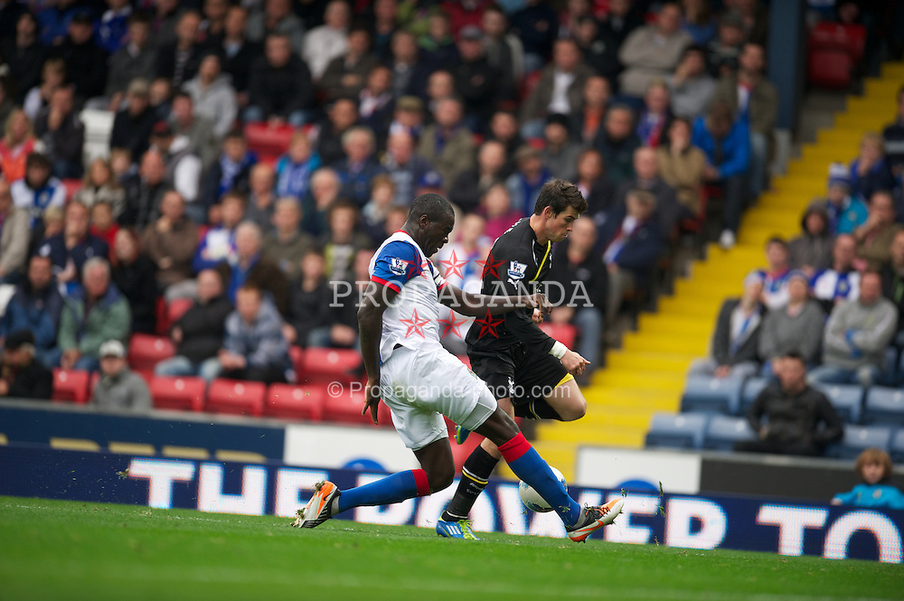BLACKBURN, ENGLAND - Sunday, October 23, 2011: Tottenham Hotspur's Gareth Bale and Blackburn Rovers' Christopher Samba during the Premiership match at Ewood Park. (Pic by David Rawcliffe/Propaganda)
