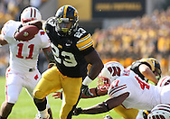 18 OCTOBER 2008: Iowa running back Shonn Greene (23) gets away from a diving Wisconsin linebacker Jaevery McFadden (47) and runs 12 yards for a touchdown in the first half of an NCAA college football game against Wisconsin, at Kinnick Stadium in Iowa City, Iowa on Saturday Oct. 18, 2008. Iowa won 38-16.