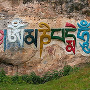 Inscription reading 'Om mani padme hum', near Langmusi, Gansu, China