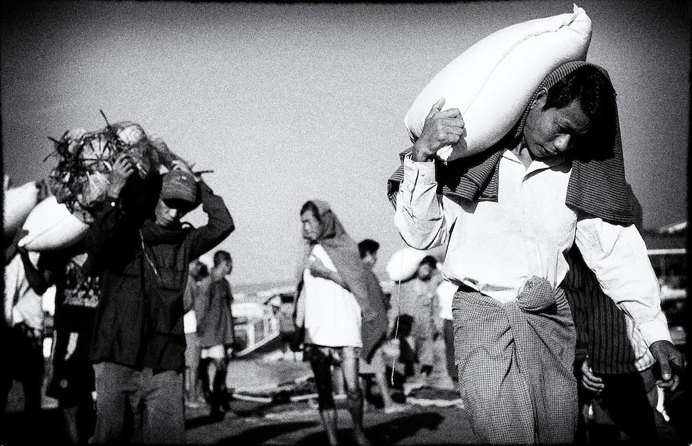 Unloading goods from boats at Yangon's Port. Yangon (Rangoon) Myanmar (Burma) January 2012