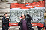 Dan Ingreji, speaking at the Pay Cap demo. PCS members working in the civil service are holding a short, high profile protest to demonstrate about the continued 1% pay cap public sector pay cap that has been in place for 7 years.Westminster,  London,  United Kingdom. (Photo by Andy Aitchison / PCS)