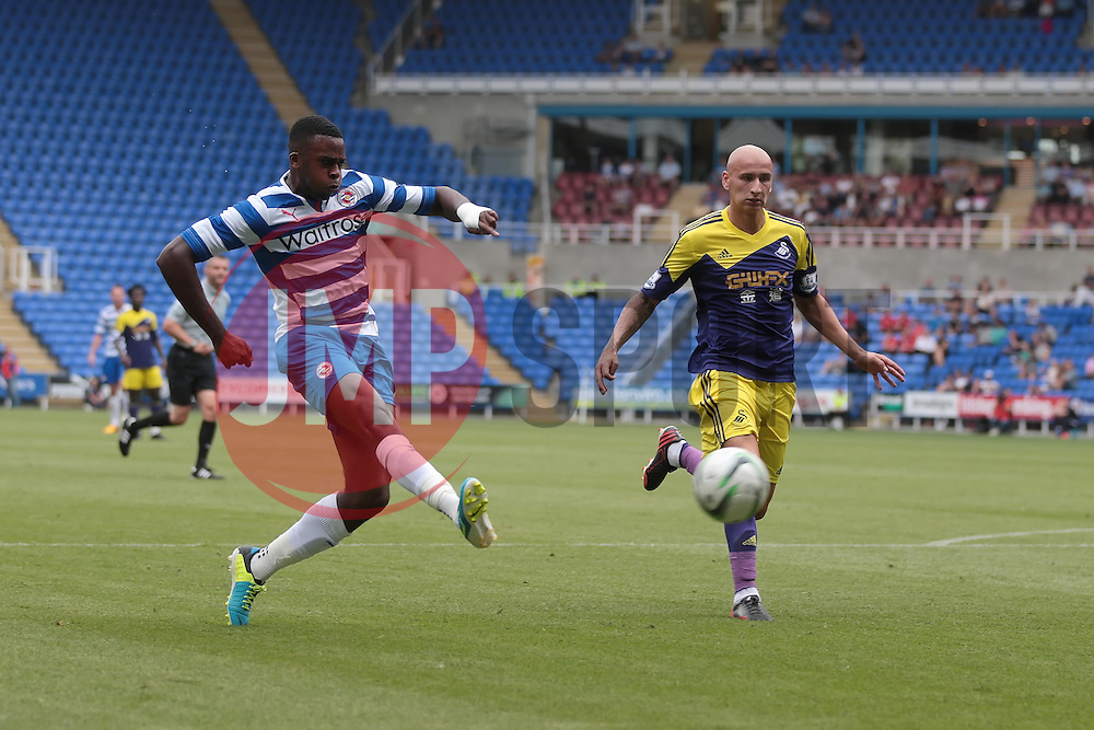Reading midfielder Hope Akpan (16) has a shot on goal during the pre-season friendly game between Reading and Swansea City.  Photo mandatory by-line: Nigel Pitts-Drake/JMP  - Tel: Mobile:07966 386802 27/07/2013 - Reading v  Swansea City  - SPORT - FOOTBALL - pre-season - Reading - Madejski Stadium