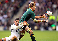 © SPORTZPICS / Seconds Left Images 2010 - Juan Smith keeps the ball moving despite England's Shontayne Hape 's tackle -  England v South Africa  - Investec Challenge Series - 27/11/20110 - Twickenham Stadium  - London - All rights reserved.