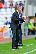 Manager of Portsmouth FC, Kenny Jackett encourages his players during the EFL Sky Bet League 1 match between Sunderland and Portsmouth at the Stadium Of Light, Sunderland, England on 17 August 2019.